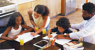 Buy stock photo Cropped shot of parents helping their two children with their schoolwork at home