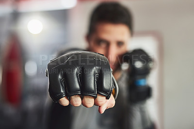 Buy stock photo Cropped portrait of a professional fighter training in the gym