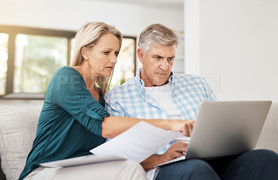 Buy stock photo Cropped shot of a mature couple doing their household budget at home