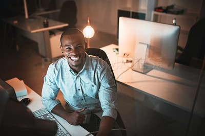 Buy stock photo High angle portrait of a handsome young male designer working on his computer in the office