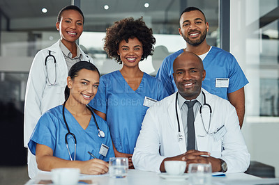 Buy stock photo Portrait of a group of medical practitioners working together in a hospital