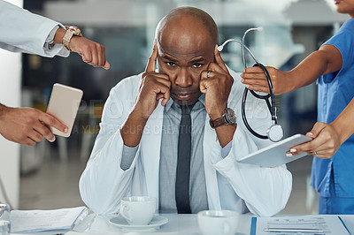 Buy stock photo Portrait of a doctor looking stressed out in a demanding work environment