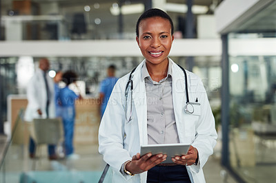 Buy stock photo Portrait of a doctor using a digital tablet in a hospital