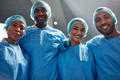 Buy stock photo Portrait of a group of surgeons standing together in a hospital