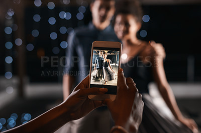 Buy stock photo Defocused shot of a couple having their picture taken while on a date