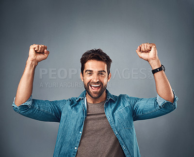 Buy stock photo Studio shot of a handsome young man cheering against a grey background