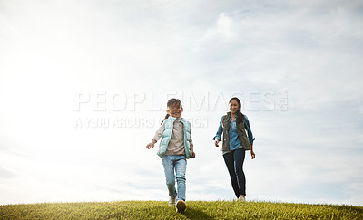 Buy stock photo Shot of an adorable little girl out for a walk with her mom