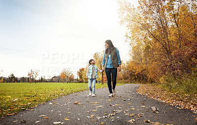 Buy stock photo Shot of a mother and her little daughter enjoying a walk outdoors