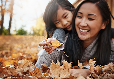 Buy stock photo Shot of an adorable little girl enjoying an autumn day outdoors