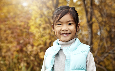 Buy stock photo Portrait of an adorable little girl standing outdoors