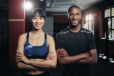 Buy stock photo Portrait of two young people at the gym for a workout