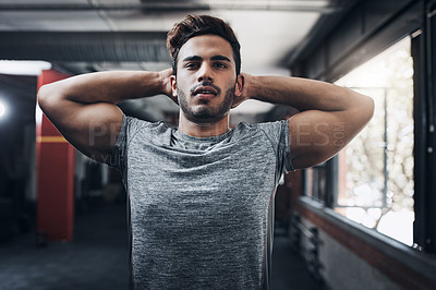 Buy stock photo Portrait of a handsome young man at the gym for a workout