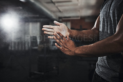 Buy stock photo Cropped shot of an unrecognizable man dusting his hands with talcum powder