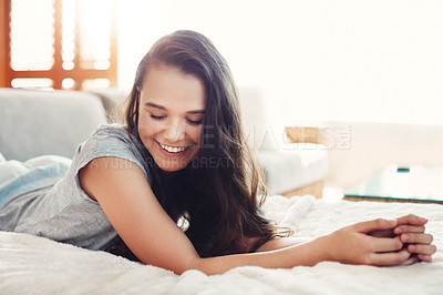 Buy stock photo Shot of an attractive young woman spending a relaxing day on her bed at home