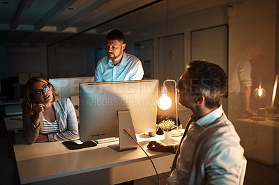 Buy stock photo Shot of a group of businesspeople working late in an office