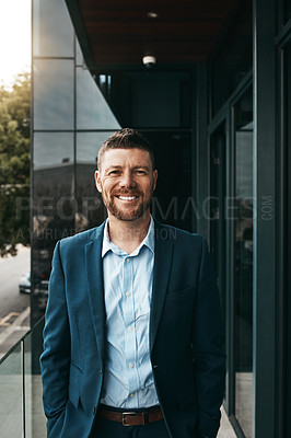 Buy stock photo Portrait of a mature businessman standing on the office balcony