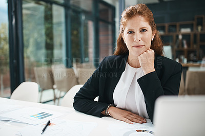 Buy stock photo Shot of a businesswoman working in an office