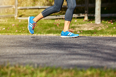 Buy stock photo Closeup shot of an unrecognizable woman running outdoors