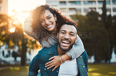 Buy stock photo Portrait of a young couple having fun together outdoors