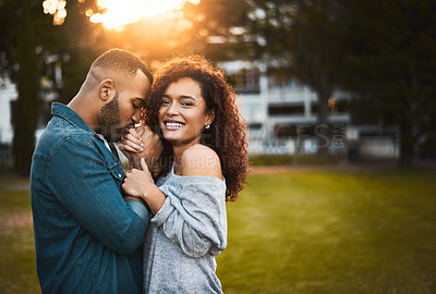 Buy stock photo Shot of a young beautiful couple spending the day in a public park