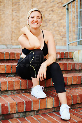 Buy stock photo Portrait of an attractive young woman taking a break during a workout in the city