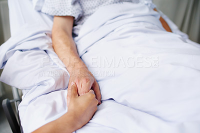 Buy stock photo Closeup shot of an unrecognizable woman's hand holding her father's in comfort at the hospital
