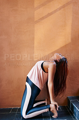Buy stock photo Shot of a young woman practising yoga