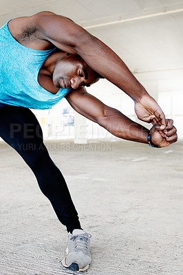 Buy stock photo Shot of a handsome and sporty young man working out in an underground parking lot