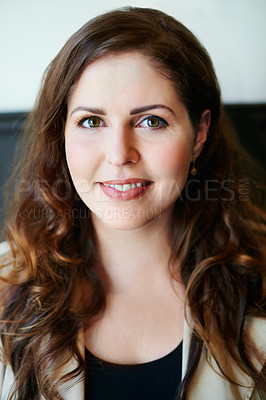Buy stock photo Portrait of an attractive young woman sitting in a cafe