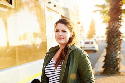 Buy stock photo Cropped shot of a beautiful young woman commuting outside
