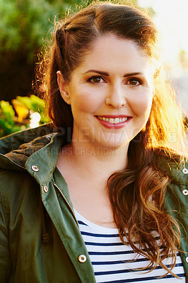 Buy stock photo Portrait of a beautiful young woman spending the day outside