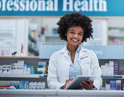 Buy stock photo Portrait of a young pharmacist working on a digital tablet in a chemist