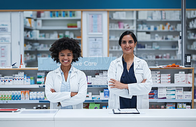 Buy stock photo Portrait of two pharmacists working in a chemist