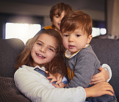 Buy stock photo Cropped portrait of an adorable little girl and her two brothers in their living room at home