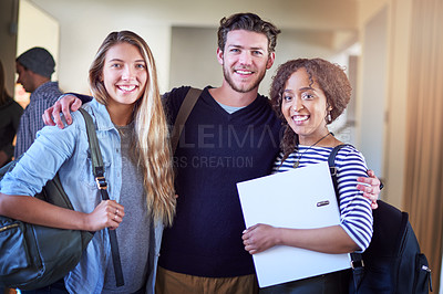 Buy stock photo Portrait of a group of university students standing in a corridor at campus
