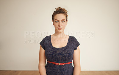 Buy stock photo Cropped portrait of an attractive young woman standing in her home