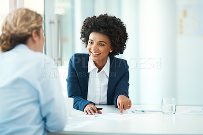 Buy stock photo Cropped shot of a professional businesswoman talking to a client