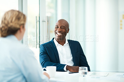 Buy stock photo Defocused shot of a woman meeting with a professional businessman