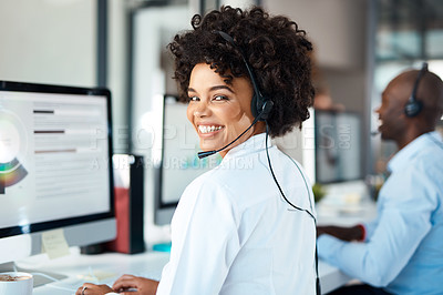 Buy stock photo Portrait of a young call centre agent working alongside her colleagues in an office