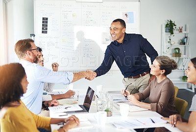 Buy stock photo Cropped shot of two businessmen shaking hands during a meeting in the boardroom