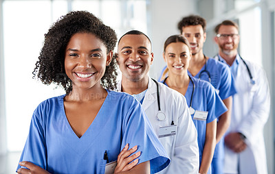 Buy stock photo Portrait of a diverse team of doctors standing together in a hospital