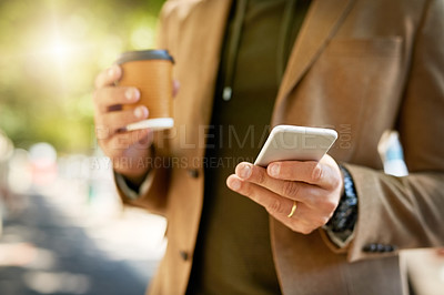 Buy stock photo Cropped shot of an unrecognizable man sending a text message during his morning commute