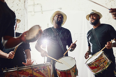 Buy stock photo Shot of a group of musical performers playing drums together
