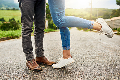 Buy stock photo Cropped shot of an unrecognizable couple standing outdoors