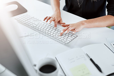 Buy stock photo Cropped shot of a businesswoman using a computer at her desk in a modern office