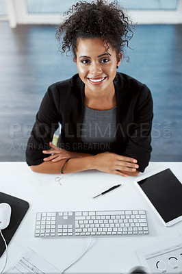 Buy stock photo High angle portrait of a young businesswoman working at her desk in a modern office