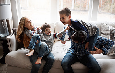 Buy stock photo Shot of two adorable little boys having fun with their parents at home