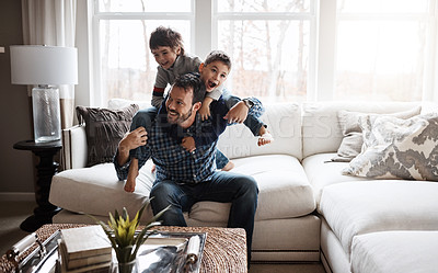 Buy stock photo Shot of two adorable little boys having fun with their father at home