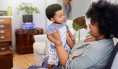 Buy stock photo Cropped shot of a young mother spending time with her baby girl