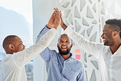 Buy stock photo Shot of a group of businessmen high fiving together in an office